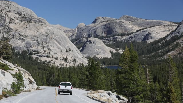 a car travelling from lee vining into yosemite national park, california, usa. - yosemite national park stock videos and b-roll footage