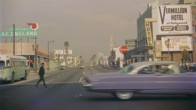 stockvideo's en b-roll-footage met 1956 pov car travelling west down hollywood avenue / los angeles, united states - hollywood california