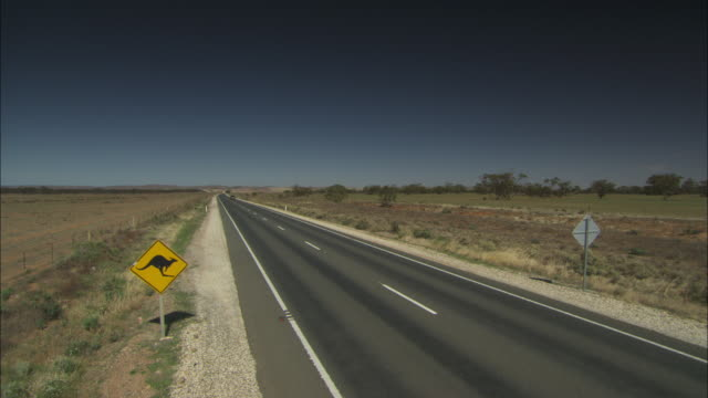 A car travels along a highway in Southern Australia.