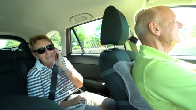car trip, senior couple driving in car on sunny day - windschutzscheibe stock-videos und b-roll-filmmaterial