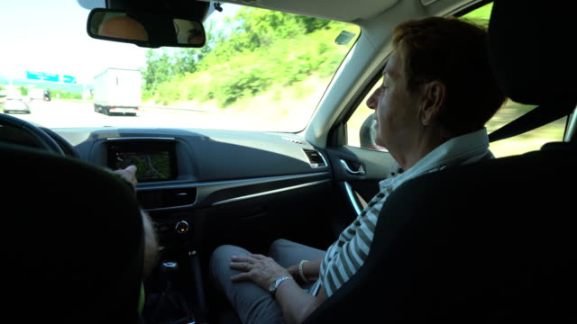 car trip, senior woman in car - passenger seat stock videos and b-roll footage