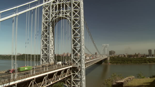 Car, trucks and pedestrians cross the span of The George Washington Bridge from New Jersey to New York City.