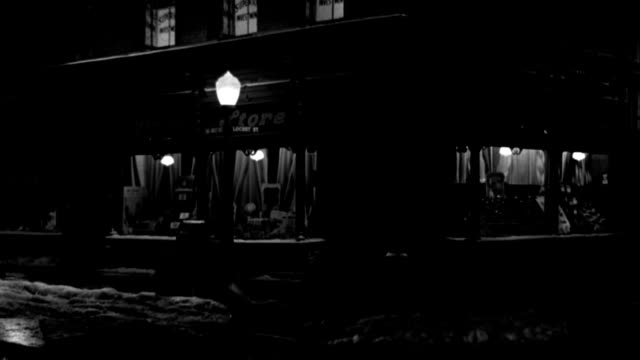 a 1949 car turns a corner past a drug store on a quiet street. - 1949 stock videos & royalty-free footage