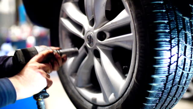 car tyre replacement. - mechanic stock videos & royalty-free footage