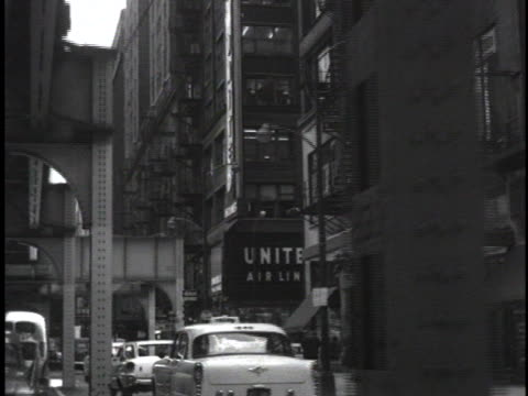 car under elevated bridge in chicago. - elevated train stock videos & royalty-free footage