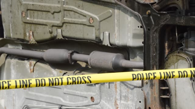 Car undercarriage and police tape