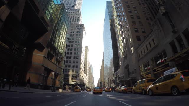 car pov view of driving through new york city manhattan streets. urban metroplis background - taxi stock videos & royalty-free footage