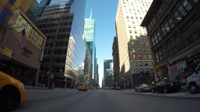 Car POV view of driving through new york city manhattan streets. urban metroplis background