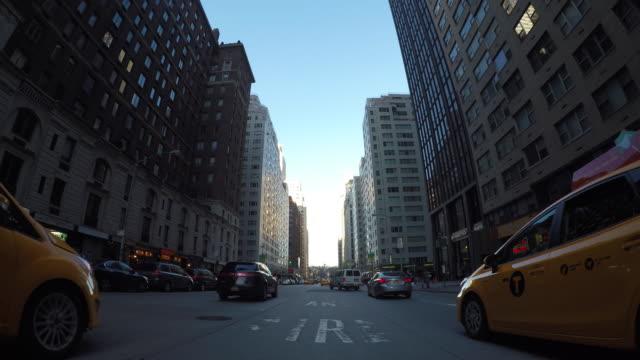 car pov view of driving through new york city manhattan streets. urban metroplis background - stoplight stock videos & royalty-free footage