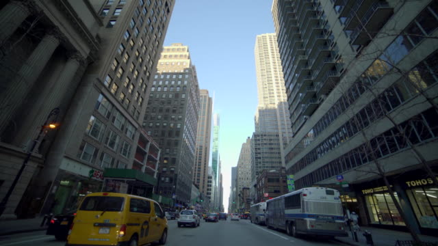 car pov view of new york city streets and buildings. urban metropolis background - car point of view stock videos and b-roll footage