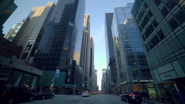 Car POV view of new york city streets and buildings. urban metropolis background