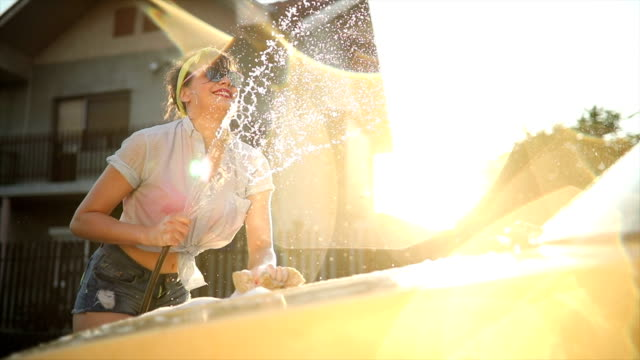 car washing in the sunset - car wash stock videos & royalty-free footage
