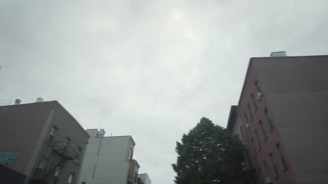 car window view while driving through greenpoint brooklyn - passenger seat stock videos & royalty-free footage