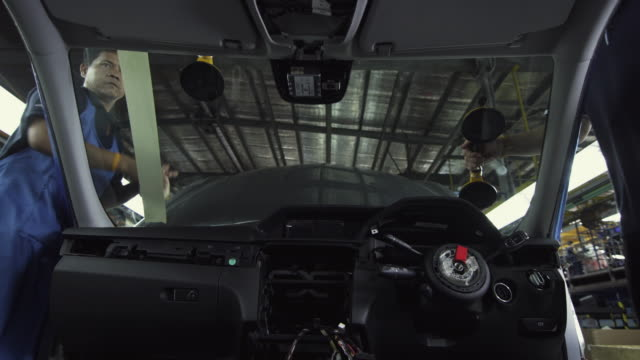 MS LA Car windshield being installed on production assembly line / Samut Prakan, Bang Muang Mai, Thailand