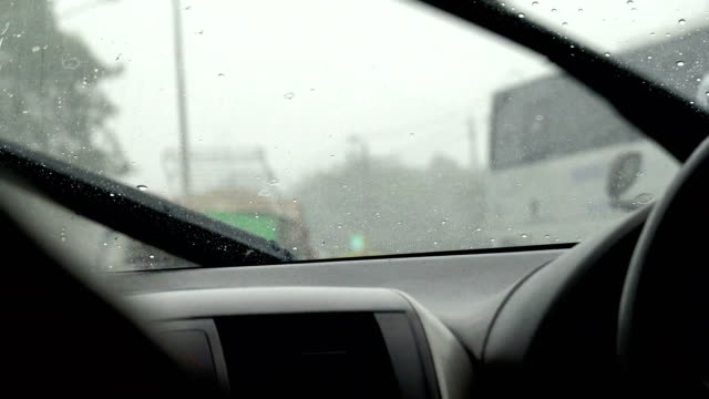 car wiper working clean water drop on windshield - handle stock videos & royalty-free footage