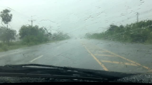 car wipers are removing rain at slow and drive on road - blade stock videos & royalty-free footage