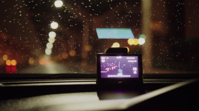 a car with a navigator on a smartphone - global positioning system stock videos & royalty-free footage