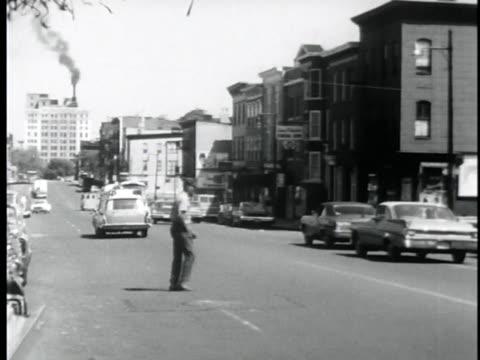 vidéos et rushes de car with a newark city sign drives through the slums. - new jersey