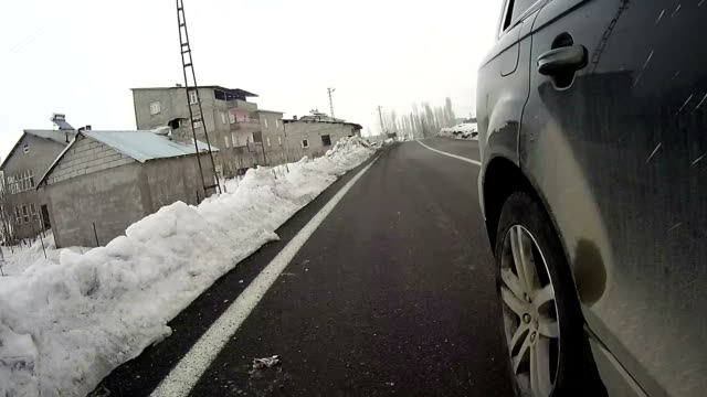 Car with action cam on the village road