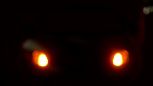 car with flashing hazard lights at night - stealth stock videos and b-roll footage