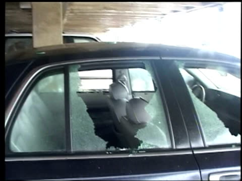 car with shattered windows due to flying gravel in car park during hurricane katrina, gulfport, mississippi; 29 august 2005 - fensterfront stock-videos und b-roll-filmmaterial
