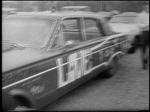 car with slogans painted on it + male hippie painting car outdoors / detroit - 1967 stock videos & royalty-free footage