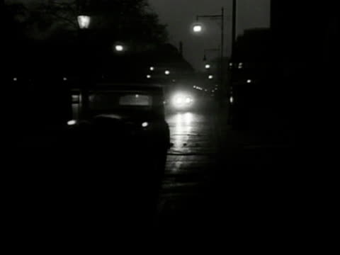 car w/out headlights driving down london street car w/ headlights tailing ws first car taking turn around corner at high speed second car following - 1949 stock videos and b-roll footage
