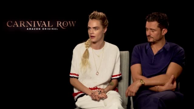 "cara delevingne has explained why the fairy she plays in carnival row has an irish accent saying ""it just made more sense"" the british model and... - orlando bloom stock videos & royalty-free footage"