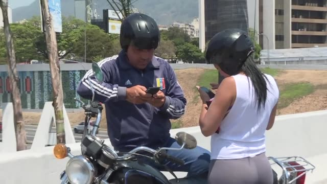 caracas residents desperatly check their mobile phones looking for a connectivity area during the power outage as a near nationwide blackout is... - latin america stock videos & royalty-free footage