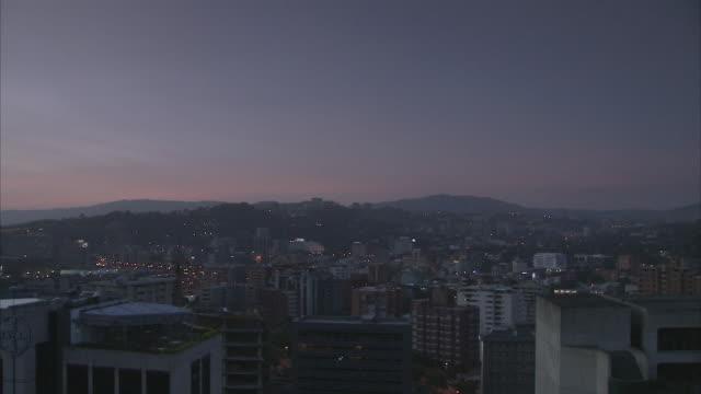 WS HA PAN Caracas skyline with Federico Quiroz neighborhood on distant hillside / Metropolitan District of Caracas, Miranda, Venezuela