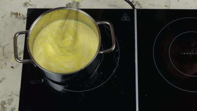 caramel sauce preparation - wire whisk stock videos and b-roll footage