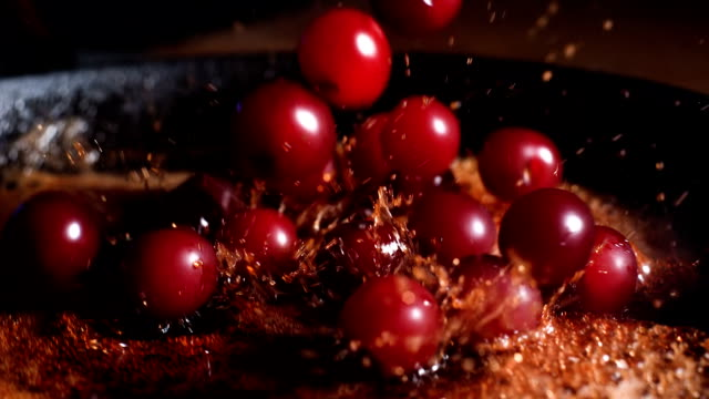 caramelized cherries. throwing and mixing cherries with caramel - dessert stock videos & royalty-free footage