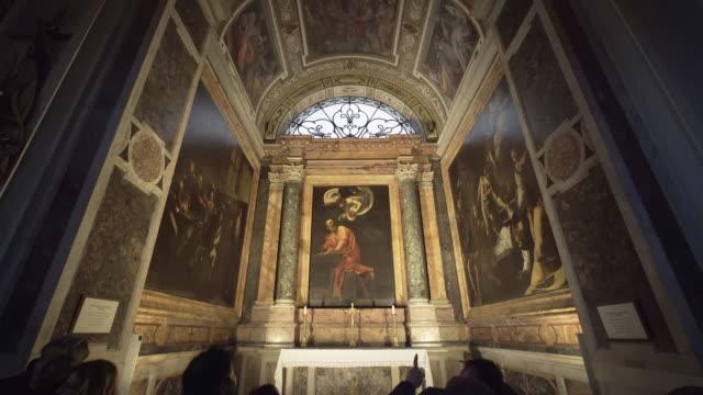 caravaggio in the contarelli chapel, san luigi del francese, rome - renaissance stock videos & royalty-free footage