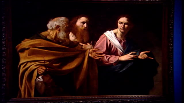 caravaggio painting rediscovered music overlay classical piano music close shot of caravaggio painting the calling of saint peter and andrew ends - digital composite stock videos & royalty-free footage