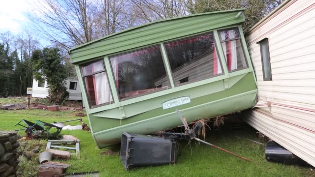 caravan park that contained around thirty static caravans in bolton, near appleby, cumbria, uk, all of the vans were damaged and many destroyed when... - trapped stock videos & royalty-free footage