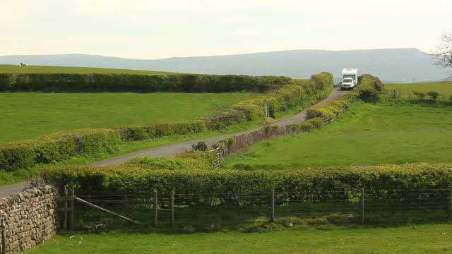 caravan trailer towed through the countryside - towing stock videos and b-roll footage