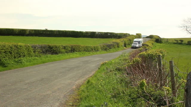 caravan trailer travelling being towed through the countryside - camping stock videos & royalty-free footage
