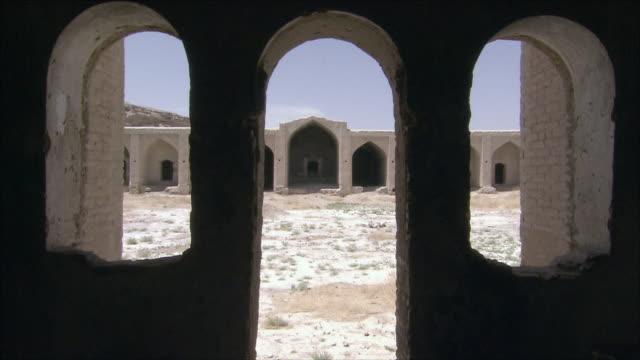 ms caravanserai courtyard seen through doorway and window frames, iran - inn stock videos & royalty-free footage