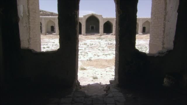 ws tu caravanserai courtyard seen through doorway and window frames, iran - inn stock videos & royalty-free footage