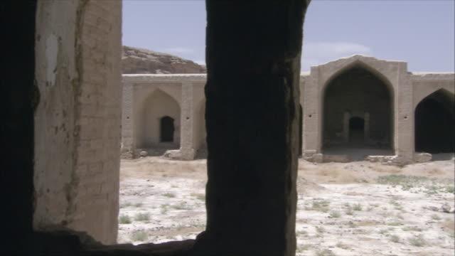 ms pan caravanserai courtyard seen through doorway and window frames, iran - inn stock videos & royalty-free footage