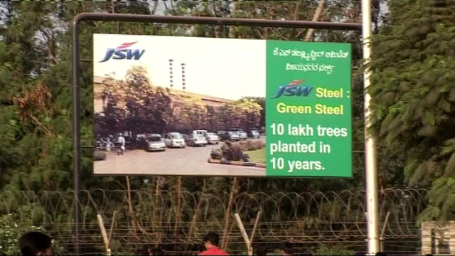 Carbon trading schemes may not be working Karnataka Industrial steel complex Entrance to JSW plant Sign at entrance Workers arriving at plant