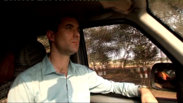 Carbon trading schemes may not be working TRACKING SHOT along road from open window of car Reporter in car as along en route to Karnataka TRACK along...