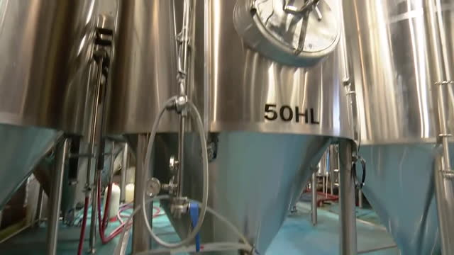 carbonated beer cans on production line and tanks of carbon dioxide in brewery - refreshment stock videos & royalty-free footage