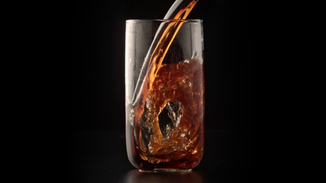 carbonated cola drink pouring into glass - cola stock videos & royalty-free footage