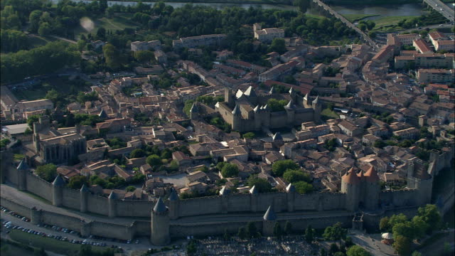 carcassonne castle  - aerial view - languedoc-roussillon, aude, arrondissement de carcassonne, france - aude stock videos & royalty-free footage