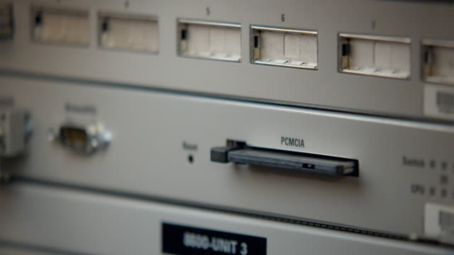 CU PCMCIA Card being removed from server, Sydney, Australia