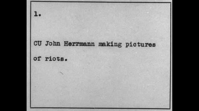 cu john herrmann making pictures of riots / semirear cu cameraman john herrmann takes film with movie camera - newsreel stock videos & royalty-free footage