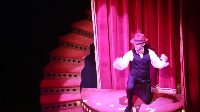 a card player with red hat during the show tango porteno in buenos aires argentina playing in a spot light - tangoing stock videos & royalty-free footage