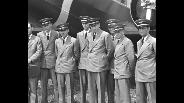 card with intro notes / row of parked biplanes on field at teterboro airport / honduras coat of arms / group of eight pilots standing in front of... - portello video stock e b–roll