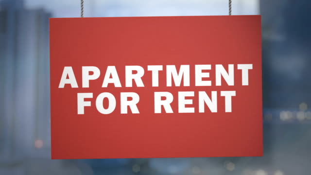 Cardboard apartament for rent sign hanging from ropes. Luma matte included so you can put your own background.
